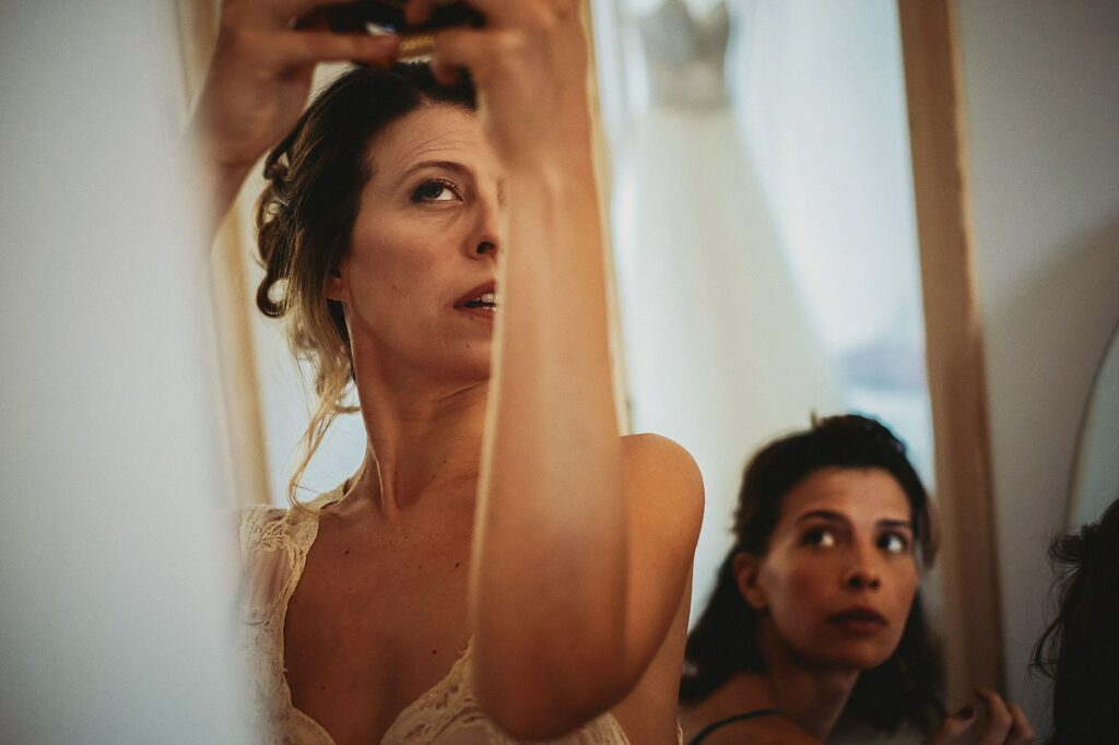 bride is getting ready for the funny wedding at il conventino in mentana