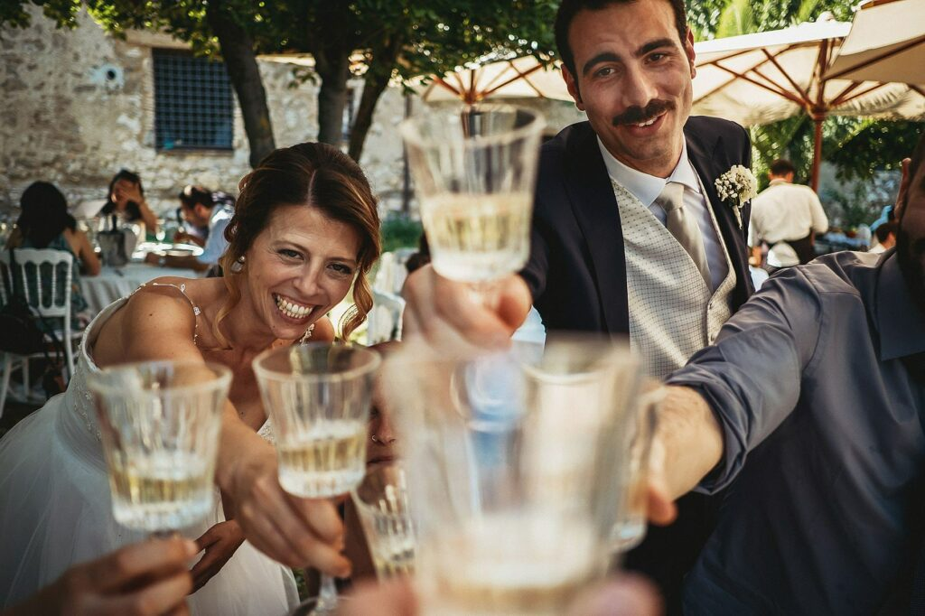 bride and groom toasting with guests during wedding at il conventino