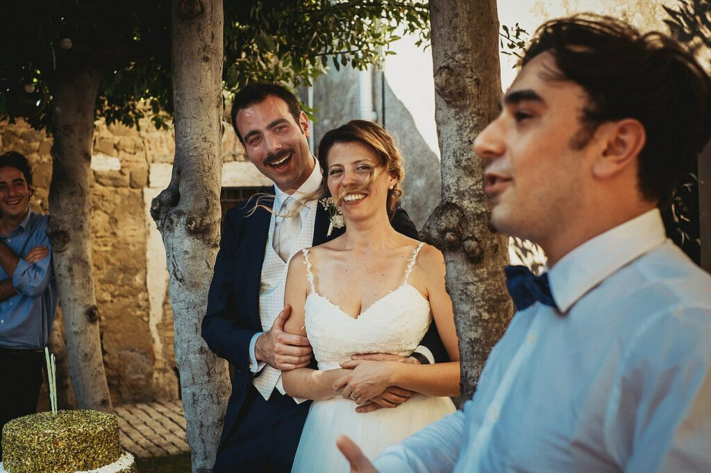 bride and groom listening to the speech of the best man during the wedding at il Conventino