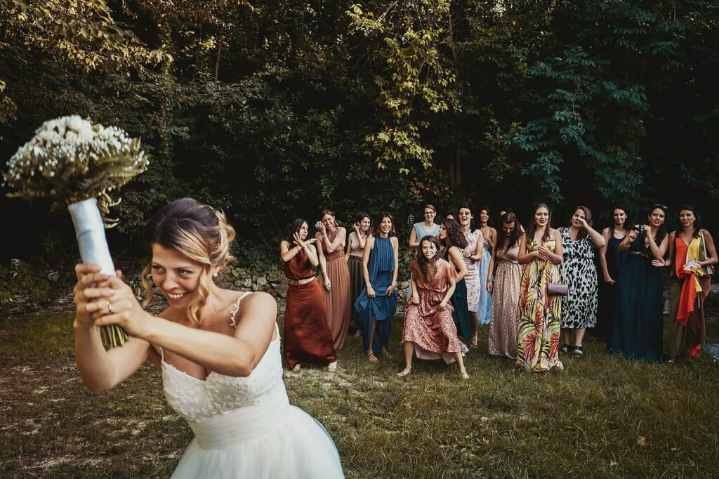 at the end of the wedding at il conventino the bride throws the bouquet and all her friends compete to get it