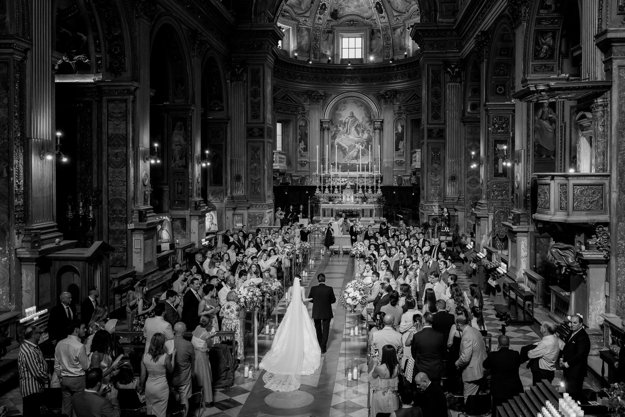 entry of the bride with her father into the church in an image captured by the wedding photographer rome