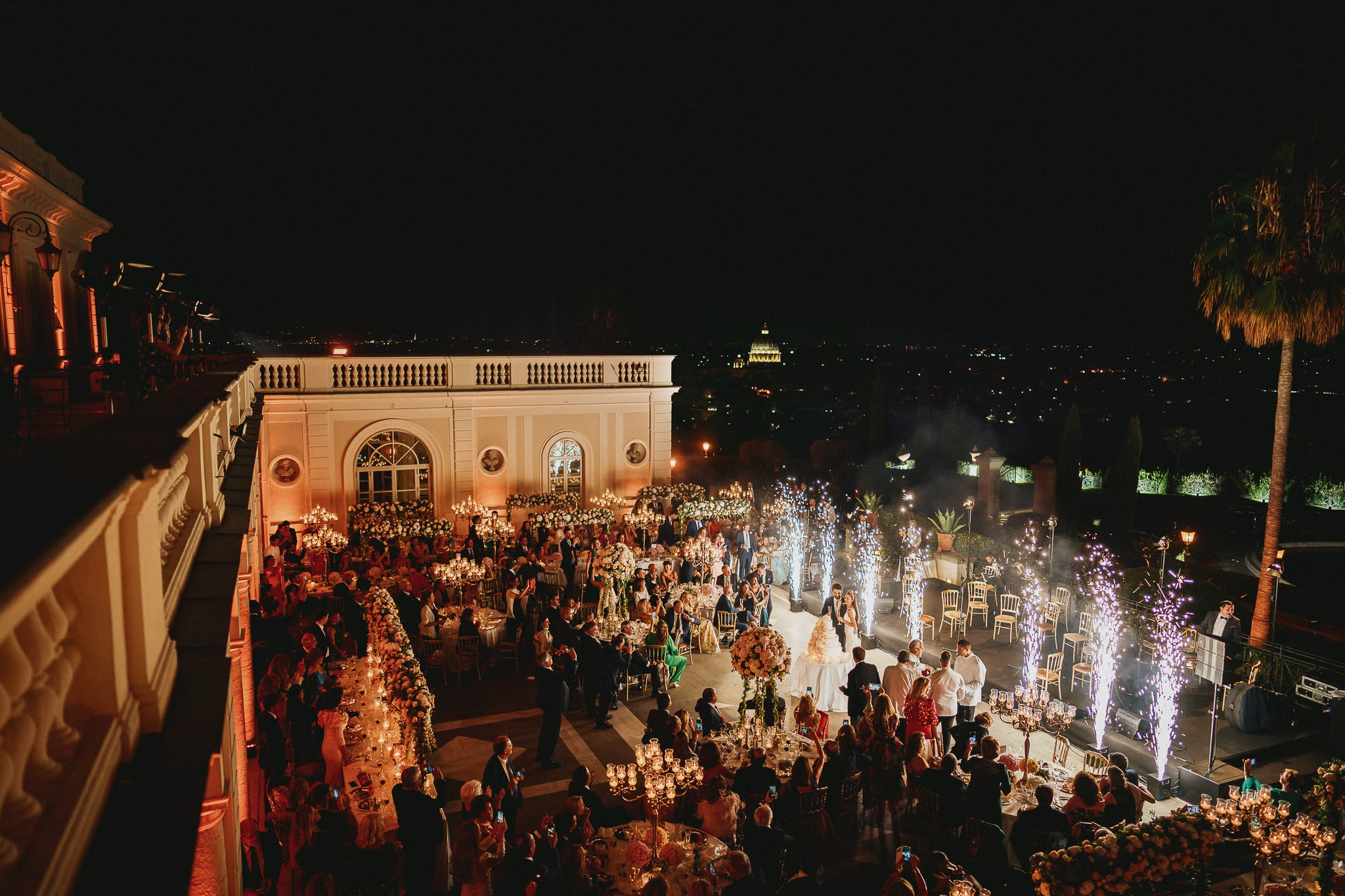 wedding photographer rome immortalized the spectacular cake cutting at villa miani with fireworks and the lights of the eternal city in the background