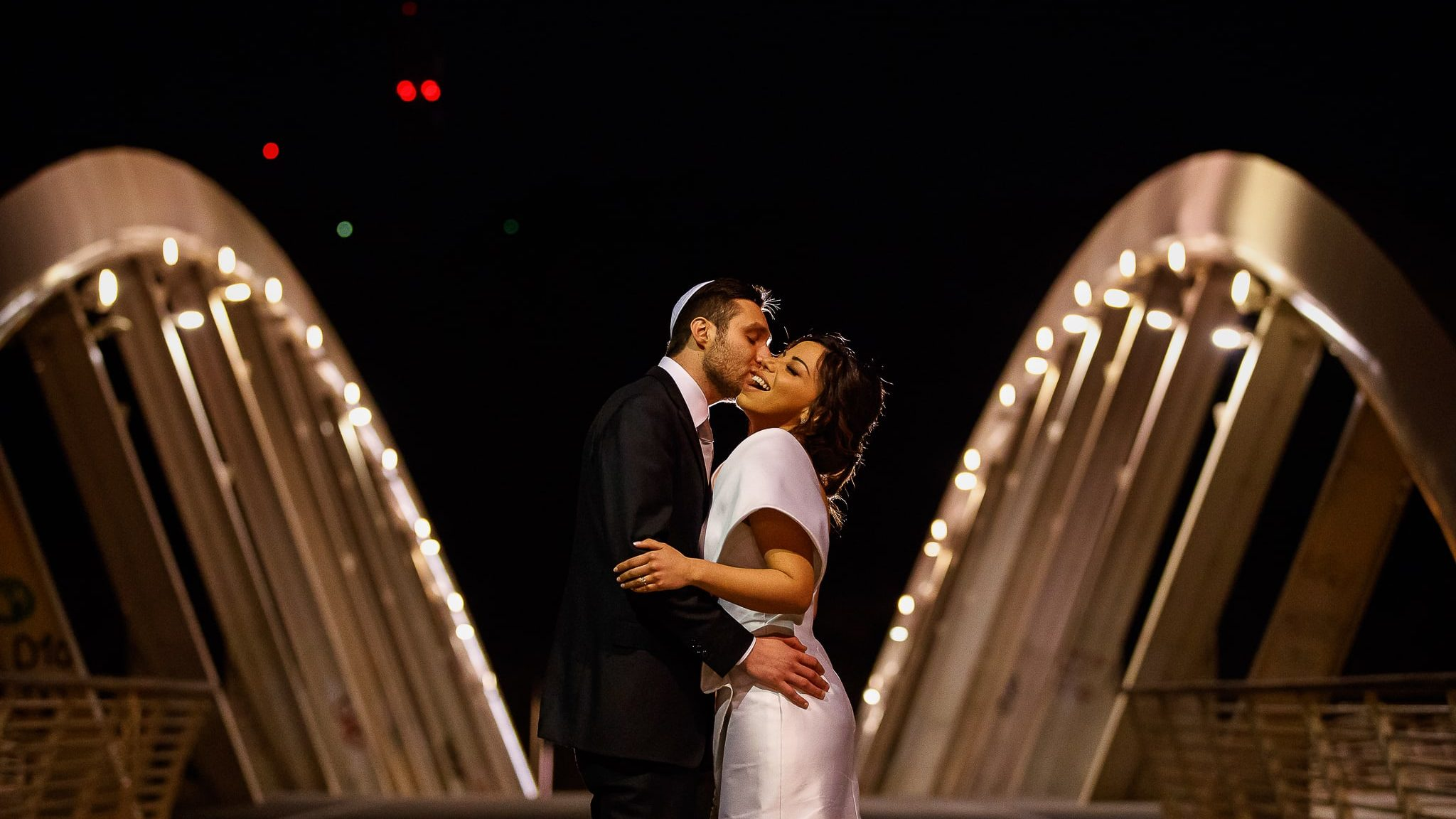 portrait of bride and groom at night on a bridge in rome