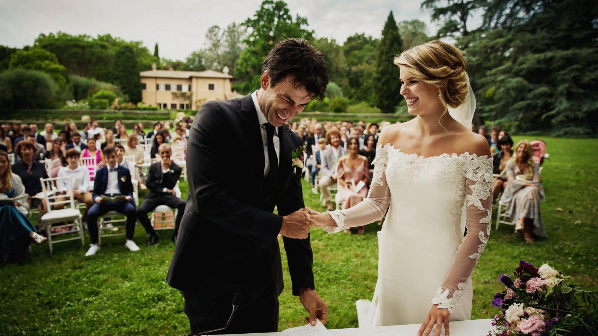 bride and groom exchanging vows at kledi kadiu wedding ceremony