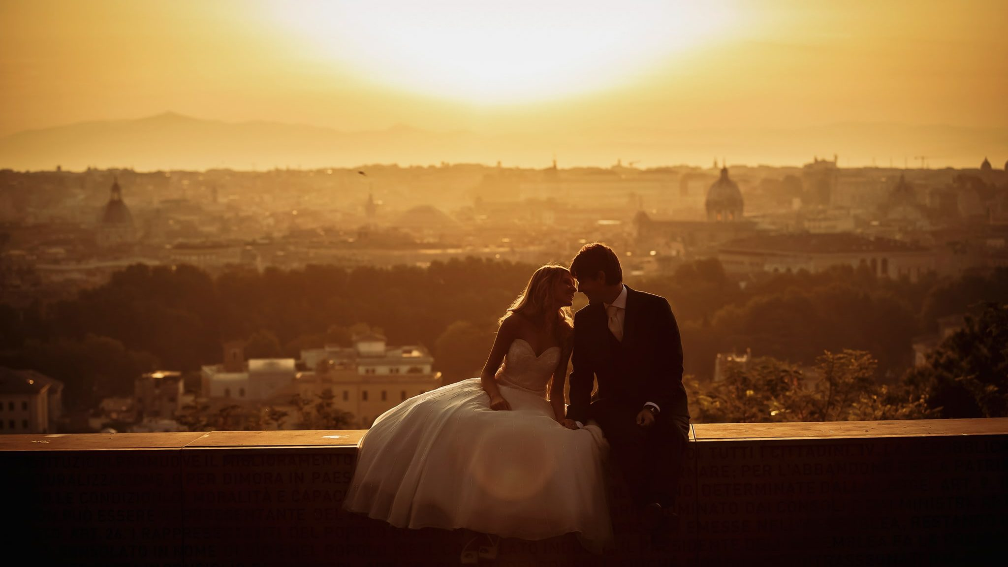post-wedding photo shoot of the newlyweds with rome in the background at dawn